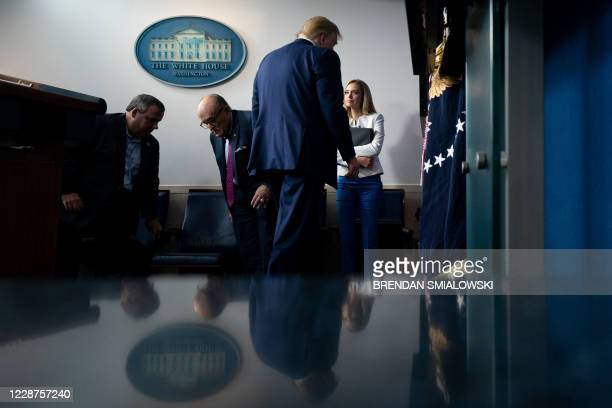 Former New Jersey Governor Chris Christie, former New York City Mayor Rudy Giuliani, and White House Press Secretary Kayleigh McEnany, leave with US...