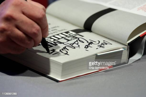 Former New Jersey Governor Chris Christie signs copies of his new book at The Washington Post January 31 2019 in Washington DC In the book titled...
