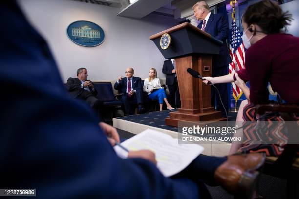 Former New Jersey Governor Chris Christie, White House Press Secretary Kayleigh McEnany, US President Donald Trump, and others listen while former...