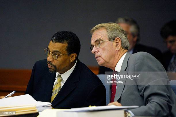 Former New Jersey Net basketball player Jayson Williams' attorneys Joseph Hayden and Billy Martin listen to Judge Edward Coleman in a Somerset County...