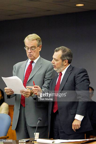 Former New Jersey Nets basketball player Jayson Williams' attorney Joseph Hayden and First Assistant Prosecutor Steven Lember review a document in a...