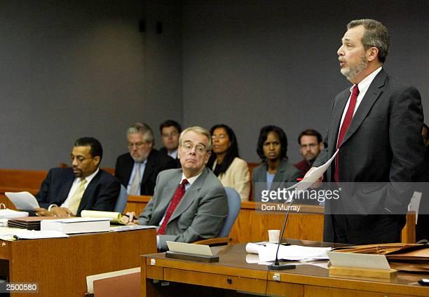 Former New Jersey Nets basketball player Jayson Williams' attorneys Joseph Hayden and Billy Martin listen to First Assistant Prosecutor Steven Lember...