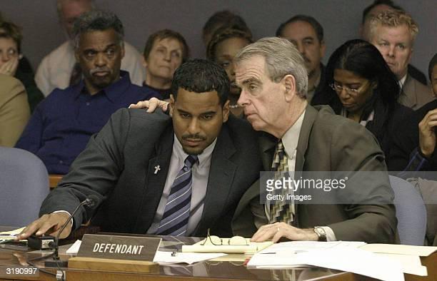 Former New Jersey Nets basketball player Jayson Williams talks with defense attorney Joseph Hayden during Williams' aggravated manslaughter trial at...