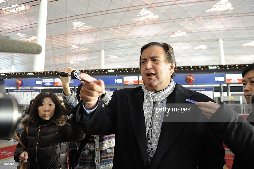 Former New Mexico Governor Bill Richardson (C) gestures as he speaks to the media at Beijing International airport in Beijing on January 7, 2013, before his trip to North Korea. Former New Mexico governor Bill Richardson and Google chairman Eric Schmidt will head to North Korea on a 'private humanitarian mission,' Richardson's office said on January 5, 2012.