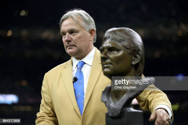 Former New Orleans Saints kicker Morten Andersen stands on the field as he receives his pro football hall of fame ring during halftime at...