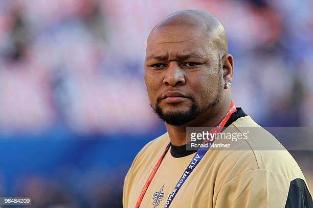 Former New Orleans Saints player Deuce McAllister watches teams warm up on the field prior to Super Bowl between the Indianapolis Colts and the New...