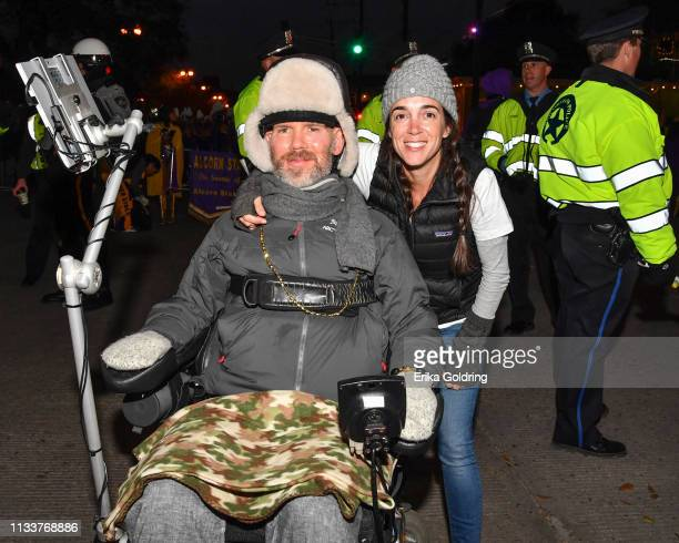 Former New Orleans Saints player Steve Gleason and his wife Michel Varisco Gleason roll in The 2019 Krewe of Orpheus parade on March 4 2019 in New...
