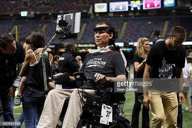 Former New Orleans Saints player Steve Gleason watches action prior to a game between the New Orleans Saints and the Atlanta Falconsat the...