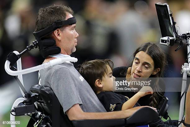 Former New Orleans Saints player Steve Gleason with his wife Michel and son Rivers before the game against the Atlanta Falcons at the MercedesBenz...