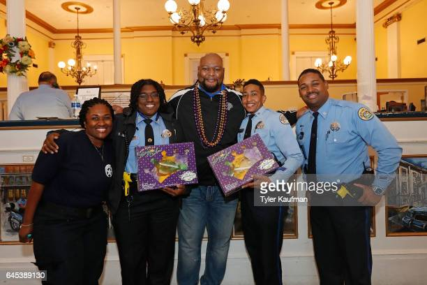 Former New Orleans Saints running back Deuce McAllister hands out King Cakes to New Orleans Police Department officers as a thank you for their...