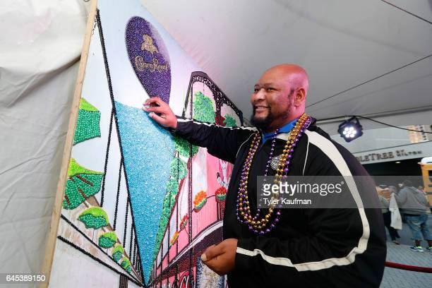 Former New Orleans Saints running back Deuce McAllister helps complete a bead mosaic at the Crown Royal popup event on February 25 2017 in New...