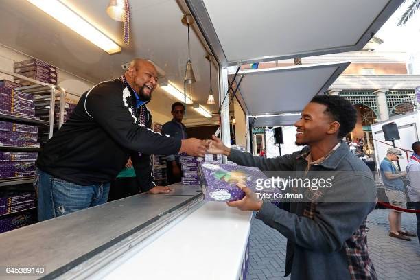 Former New Orleans Saints running back Deuce McAllister passes out King Cakes in exchange for Mardi Gras beads at the Crown Royal popup event on...