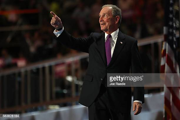 Former New York City Mayor Michael Bloomberg gestures to the crowd as he walks on stage to deliver remarks on the third day of the Democratic...