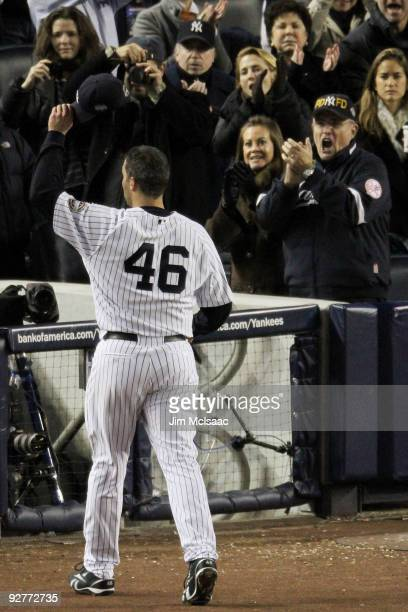 Former New York City Mayor Rudolph Giuliani and his wife Judith cheer as Andy Pettitte of the New York Yankees tips his hat to the crowd as he was...
