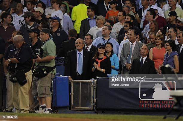 Former New York City mayor Rudolph Giuliani and wife Judith Nathan watch the pregame ceremonies before the 79th MLB AllStar Game at the Yankee...
