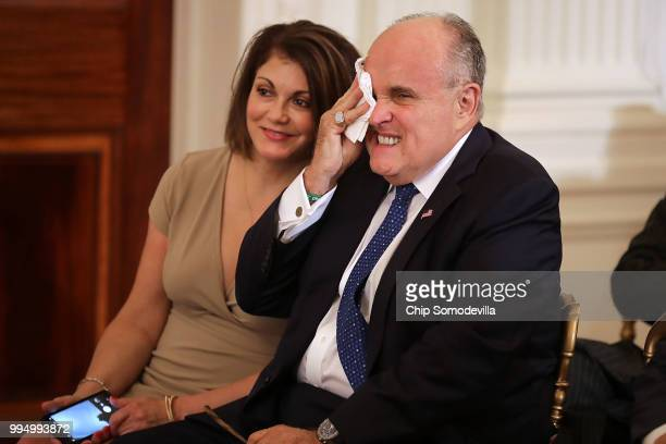 Former New York City Mayor Rudy Giuliani and Jennifer LeBlanc arrive in the East Room before US President Donald Trump introduces Judge Brett...