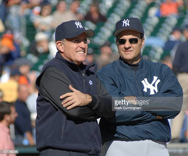 Former New York City Mayor Rudy Giuliani and New York Yankees Manager Joe Torre talk during pre-game of Game Four of the 2006 American League...