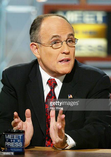 Former New York City Mayor Rudy Giuliani gestures as he speaks on NBC's 'Meet the Press' at the NBC studios December 18 2002 in Washington DC...