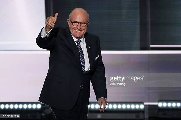 Former New York City Mayor Rudy Giuliani gives a thumbs up as he walks on stage to deliver a speech on the first day of the Republican National...