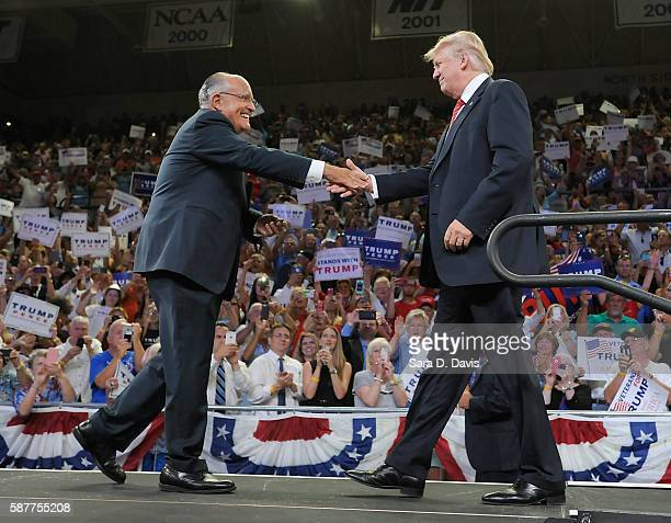 Former New York City Mayor Rudy Giuliani introduces Republican presidential candidate Donald Trump during a campaign event at Trask Coliseum on...