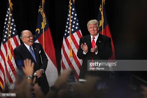 Former New York City Mayor Rudy Giuliani introduces Republican presidential candidate Donald Trump at a rally on August 18 2016 at the Charlotte...