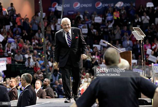 Former New York City Mayor Rudy Giuliani opens for Republican presidential nominee Donald Trump at a rally at Xfinity Arena in Everett Washington on...