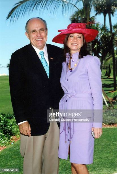 Former New York City mayor Rudy Giuliani poses with his wife Judity during Easter Sunday events at the MaraLago club in Palm Beach Florida April 16...