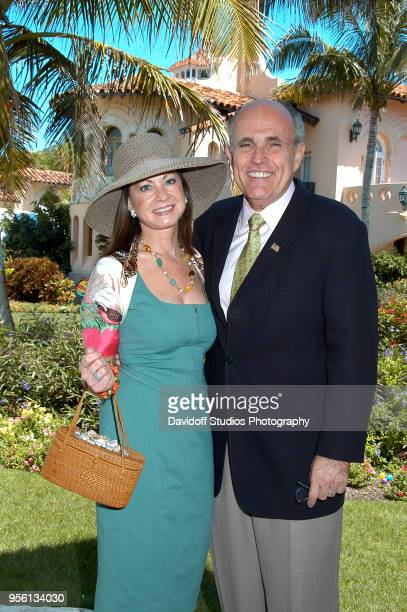 Former New York City mayor Rudy Giuliani right poses with wife Judith on Easter Sunday at the MaraLago club in Palm Beach Florida April 8 2007