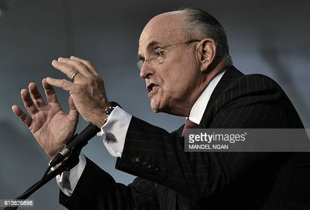 Former New York City mayor Rudy Giuliani speaks at a rally for Republican presidential nominee Donald Trump at Ambridge Area Senior High School on...