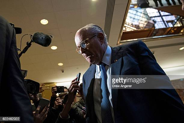 Former New York City mayor Rudy Giuliani speaks briefly with the media on his way out of the lobby of Trump Tower November 11 2016 in New York City...