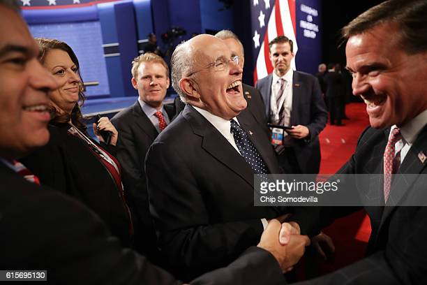 Former New York City mayor Rudy Giuliani speaks with guests before the start of the third US presidential debate at the Thomas Mack Center on October...