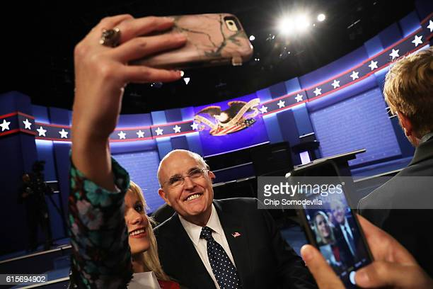 Former New York City mayor Rudy Giuliani takes a selfie before the start of the third US presidential debate at the Thomas Mack Center on October 19...