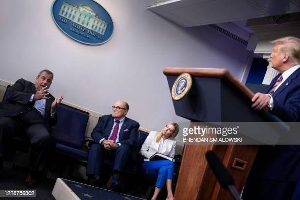 Former New York City Mayor Rudy Giuliani, White House Press Secretary Kayleigh McEnany, and US President Donald Trump listen while former New Jersey...