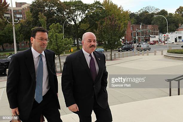 Former New York City police commissioner Bernard Kerik enters the courthouse with his lawyer for a pre-trial hearing on October 20, 2009 in White...