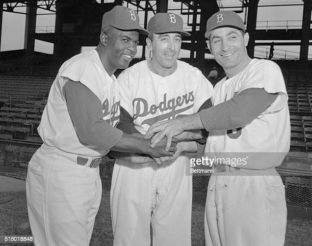 Former New York Giant and Cleveland Indian pitcher Sal Maglie is welcomed to his new home Ebbets Field by Dodgers Jackie Robinson and Carl Furillo...