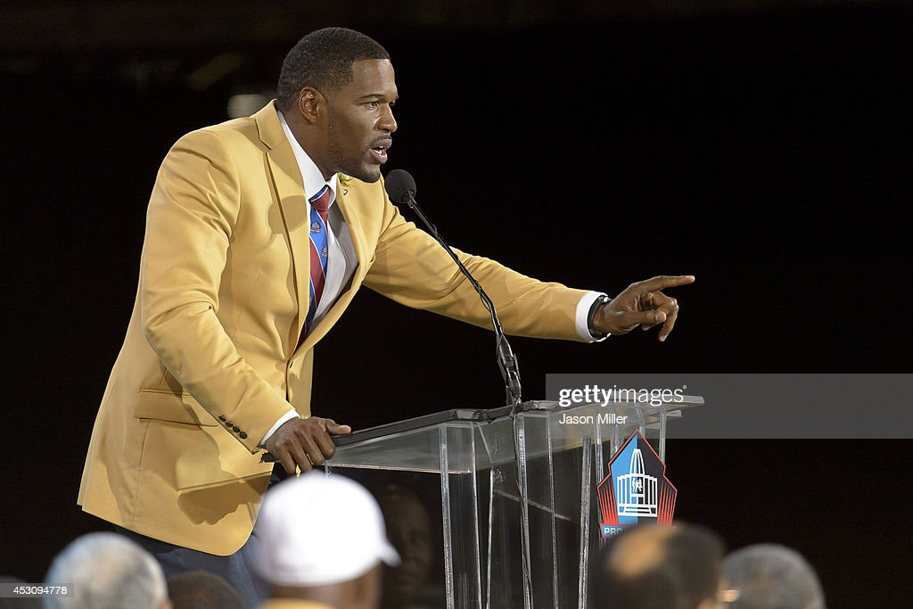 Former New York Giants defensive end Michael Strahan gives his speech during the NFL Class of 2014 Pro Football Hall of Fame Enshrinement Ceremony at Fawcett Stadium on August 2, 2014 in Canton, Ohio.