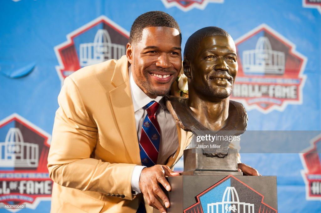 Former New York Giants defensive end Michael Strahan with his bust during the NFL Class of 2014 Pro Football Hall of Fame Enshrinement Ceremony at Fawcett Stadium on August 2, 2014 in Canton, Ohio.