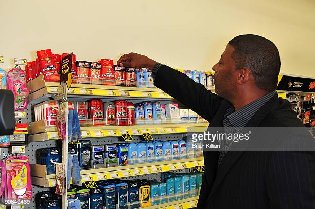 Former New York Giants linebacker Carl Banks shops Procter and Gamble products during the official opening of the Saddle Brook Dollar General Store...