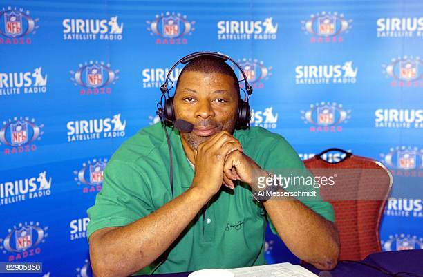 Former New York Giants linebacker Carl Banks talks to Sirus radio at the 2006 annual meeting March 28 at the Hyatt Regency Grand Cypress in Orlando