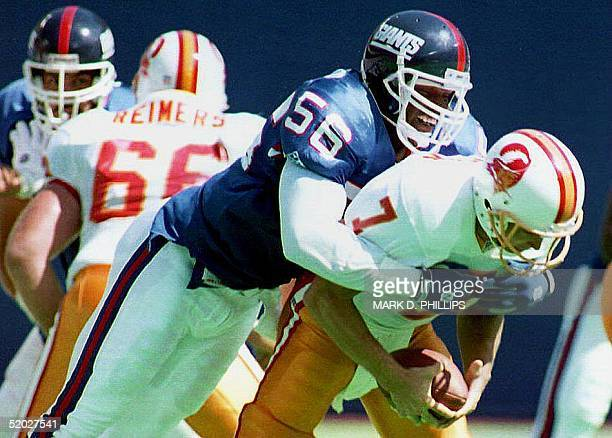 Former New York Giants linebacker Lawrence Taylor is shown sacking Tampa Bay Buccaneers quarterback Craig Erickson during their 12 September 1993...