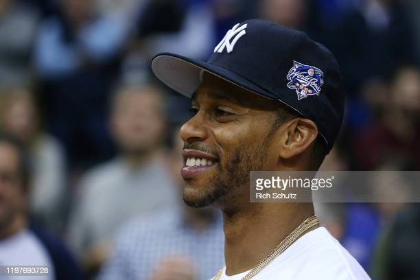 Former New York Giants wide receiver Victor Cruz attends the Georgetown Hoyas Seton Hall Pirates college basketball game at Prudential Center on...