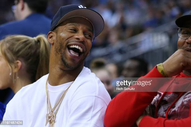 Former New York Giants wide receiver Victor Cruz watches action from the Georgetown Hoyas Seton Hall Pirates college basketball game at Prudential...