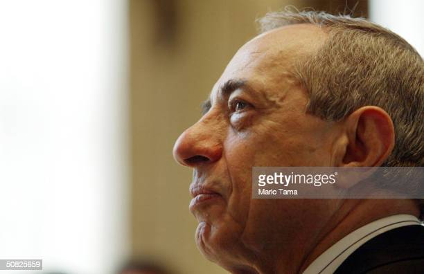 Former New York Governor Mario Cuomo looks on as NBC's Tim Russert speaks at an Association for a Better New York breakfast May 11 2004 in New York...
