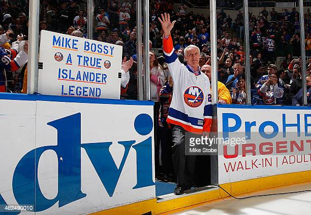 Former New York Islander and Hall of Famer Mike Bossy waves to the crowd for Mike Bossy tribute night prior to a game between the New York Islanders...