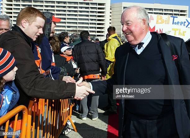 Former New York Islanders general manager Bill Torrey greets the crowd during the 'Walk of Champions' prior to the Islanders game against the Florida...