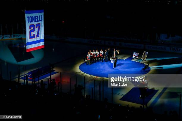 Former New York Islanders player John Tonelli has his number retired prior to the game between the New York Islanders and the Detroit Red Wings at...