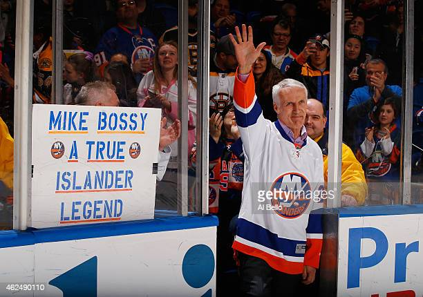 Former New York Islandes Mike Bossy waves to the crowd prior to the game duing Mike Bossy tribute Night at the Nassau Veterans Memorial Coliseum on...