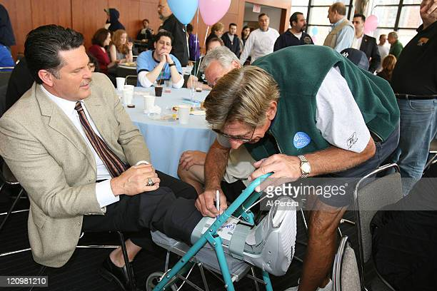 Former New York Jets Linebacker and current SNY personality Greg Buttle share a laugh with Spokesman Joe Namath while he signs his cast at the 2007...