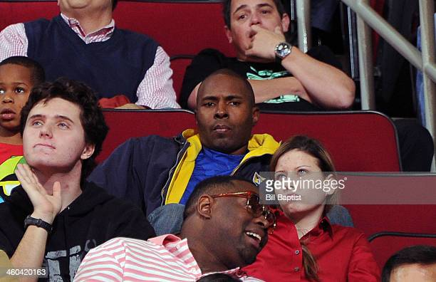 Former New York Knick NFL Player Charlie Ward watches the game between the Houston Rockets and the New York Knicks on January 3 2014 at the Toyota...