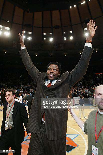 Former New York Knick Patrick Ewing aknowledges the crowd's applause as his number is retired and his jersey hoisted to the rafters of Madison Square...